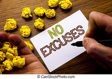 Word, writing No Excuses. Concept for Stop Ban for Excuse written on notebook note paper on the wooden background with folded paper meaning thinking for idea. Man hand and marker.
