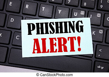 Word, writing Phishing Alert. Business concept for Fraud Warning Danger written on sticky note paper on the black keyboard background.