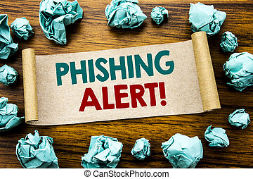 Word, writing Phishing Alert. Business concept for Fraud Warning Danger Written on sticky note paper, wooden background with folded yellow paper meaning thinking