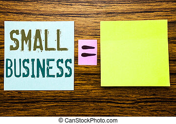 Word, writing Small Business. Business concept for Family Owned Company written on sticky note paper on wooden background. Equation mathematical sign for your space