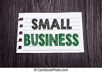 Word, writing Small Business. Business concept for Family Owned Company written on sticky note paper on the dark wooden background. Black and green.