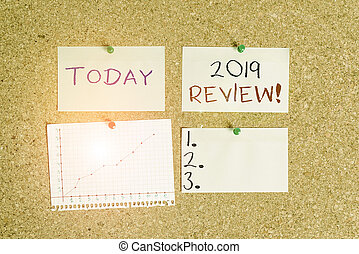 Word writing text 2019 Review. Business concept for remembering past year events main actions or good shows Corkboard color size paper pin thumbtack tack sheet billboard notice board.