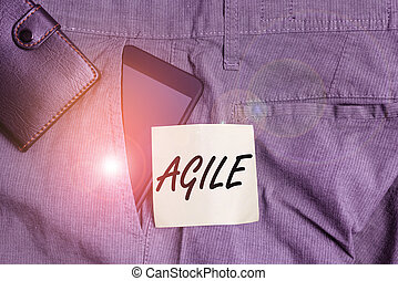 Word writing text Agile. Business concept for particular approach to project management that is utilized in software Smartphone device inside trousers front pocket with wallet and note paper.