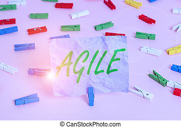 Word writing text Agile. Business concept for particular approach to project management that is utilized in software Colored clothespin papers empty reminder pink floor background office pin.