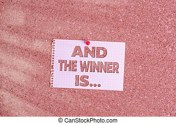 Word writing text And The Winner Is. Business concept for announcing an individual or thing that wins something Corkboard color size paper pin thumbtack tack sheet billboard notice board.