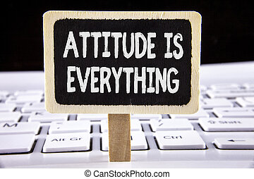 Word writing text Attitude Is Everything. Business concept for Motivation Inspiration Optimism important to succeed written on Wooden Notice Board placed on the Laptop.