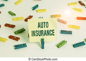 Word writing text Auto Insurance. Business concept for mitigate costs associated with getting into an auto accident Colored clothespin papers empty reminder white floor background office.