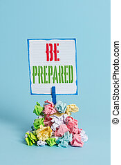 Word writing text Be Prepared. Business concept for make something ready for use or consideration at future Reminder pile colored crumpled paper clothespin reminder blue background.