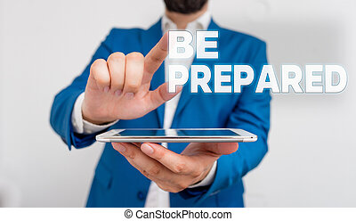 Word writing text Be Prepared. Business concept for make something ready for use or consideration at future Businessman with pointing finger in front of him.