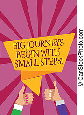 Word writing text Big Journeys Begin With Small Steps. Business concept for One step at a time to reach your goals Man woman hands thumbs up approval speech bubble origami rays background.