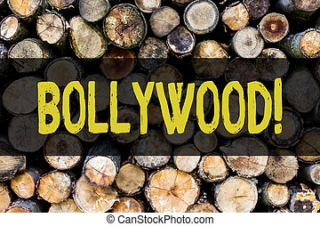 Word writing text Bollywood. Business concept for Hollywood Movie Film Entertainment Cinema Wooden background vintage wood wild message ideas intentions thoughts.