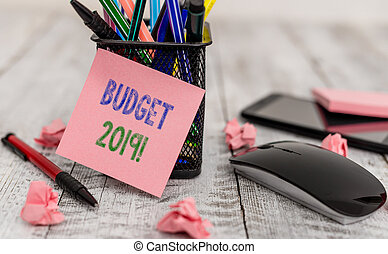 Word writing text Budget 2019. Business concept for estimate of income and expenditure for current year Writing equipment and paper plus scraps with gadgets on the wooden desk.