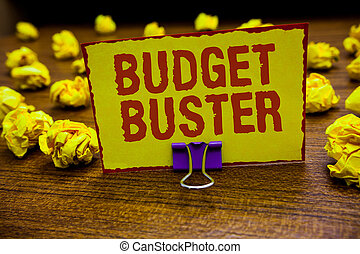 Word writing text Budget Buster. Business concept for Carefree Spending Bargains Unnecessary Purchases Overspending Clip holding yellow paper note crumpled papers several tries mistakes.