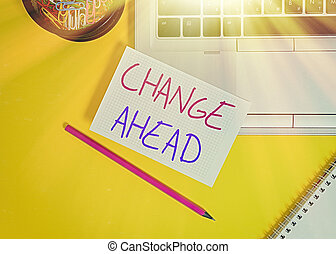 Word writing text Change Ahead. Business concept for to replace with or exchange for another Become different Laptop pencil squared paper sheet clips container spiral colored background.