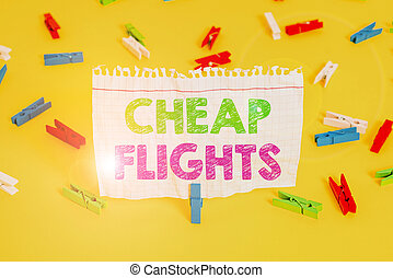 Word writing text Cheap Flights. Business concept for costing little money or less than is usual or expected airfare Colored clothespin papers empty reminder yellow floor background office.