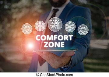 Word writing text Comfort Zone. Business photo showcasing place or situation where one feels safe and without stress Male human wear formal work suit presenting presentation using smart device