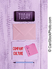 Word writing text Company Culture. Business concept for The environment and elements in which employees work Envelop smartphone notepad note clip marker old wooden vintage background.