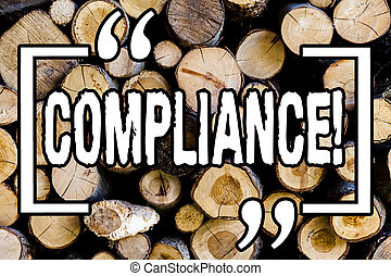 Word writing text Compliance. Business concept for Technology Company sets its policy standard regulations Wooden background vintage wood wild message ideas intentions thoughts.