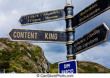 Word writing text Content Is King. Business concept for believe that content is central to the success of a website Road sign on the crossroads with blue cloudy sky in the background.