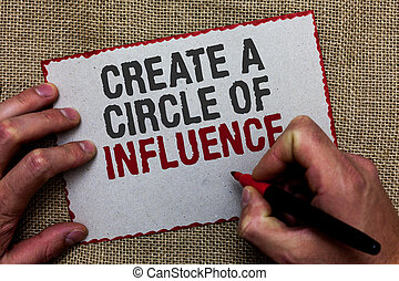 Word writing text Create A Circle Of Influence. Business concept for Be an influencer leader motivate other people On jute ground human hand written some texts on red bordered paper.