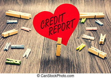 Word writing text Credit Report. Business concept for Borrowing Rap Sheet Bill and Dues Payment Score Debt History Clothespin holding red paper heart several clothespins wooden floor romance.