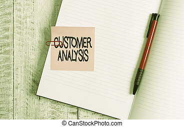 Word writing text Customer Analysis. Business concept for systematic examination of a company s is customer information Thick pages notebook stationary placed above classic look wooden backdrop.