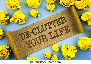 Word, writing, text De-Clutter Your Life. Business concept for Free Less Chaos Fresh Clean Routine written tear paper with folded paper the background.