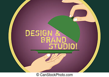 Word writing text Design And Brand Studio. Business concept for Modern designing space professional office Hu analysis Hands Serving Tray Platter and Lifting the Lid inside Color Circle.