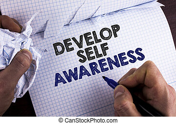 Word writing text Develop Self Awareness. Business concept for What you think you become motivate and grow written by Man on Tear Nootbook Book holding Marker on wooden background.