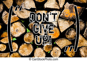 Word writing text Don T Give Up. Business concept for Keep trying until you succeed follow your dreams goals Wooden background vintage wood wild message ideas intentions thoughts.