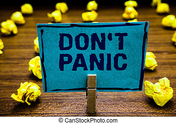 Word writing text Don t not Panic. Business concept for sudden strong feeling of fear prevents reasonable thought Clothespin holding blue paper note crumpled papers several tries mistakes.