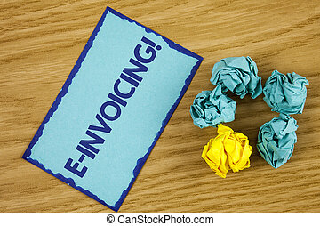 Word writing text E-Invoicing Motivational Call. Business concept for Company encourages use of digital billing written on Sticky Note paper on wooden background Paper Balls next to it.