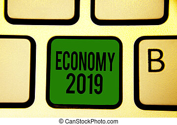 Word writing text Economy 2019. Business concept for State of wealth and resources of a country in upcoming year Keyboard green key Intention create computer computing reflection document.