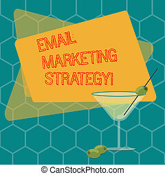 Word writing text Email Marketing Strategy. Business concept for plan of action to promote products and services Filled Cocktail Wine Glass with Olive on the Rim Blank Color Text Space.