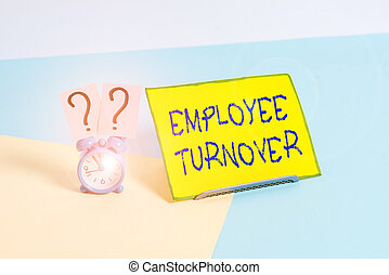 Word writing text Employee Turnover. Business concept for the percentage of workers who leave an organization Mini size alarm clock beside a Paper sheet placed tilted on pastel backdrop.