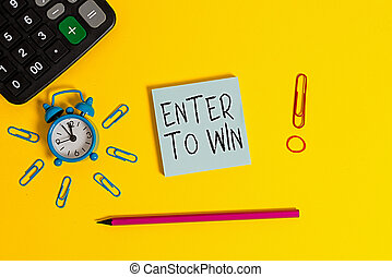 Word writing text Enter To Win. Business concept for exchanging something value for prize or chance of winning Alarm clock calculator clips rubber band pencil notepad colored background.