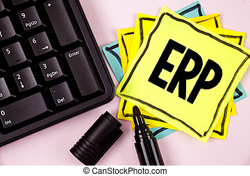 Word writing text Erp. Business concept for Enterprise resource planning with automate back office functions written on Sticky Note paper on plain background Marker and Keyboard next to it.
