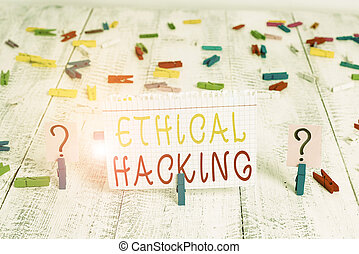 Word writing text Ethical Hacking. Business concept for act of locating weaknesses and vulnerabilities of computer Scribbled and crumbling sheet with paper clips placed on the wooden table.