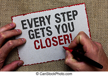 Word writing text Every Step Gets You Closer. Business concept for Keep moving to reach your goals objectives On jute ground human hand written some texts on red bordered paper.