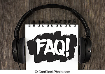 Word writing text Faq Motivational Call. Business concept for Frequently asked question for clearing up confusions written on Notepad on the wooden background Headphone next to it.