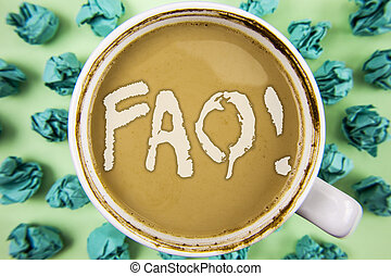 Word writing text Faq Motivational Call. Business concept for Frequently asked question for clearing up confusions written on Tea in White Cup within Crumpled Paper Balls on plain background.