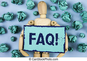 Word writing text Faq Motivational Call. Business concept for Frequently asked question for clearing up confusions written on Sticky note paper within Paper Balls on plain background Jointed Toy