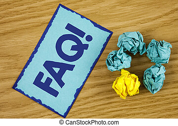 Word writing text Faq Motivational Call. Business concept for Frequently asked question for clearing up confusions written on Sticky Note paper on wooden background Paper Balls next to it.