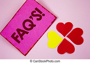 Word writing text Faq'S Motivational Call. Business concept for Multiple questions answered for online product written on Sticky note paper on plain Pink background Paper Hearts next to it.
