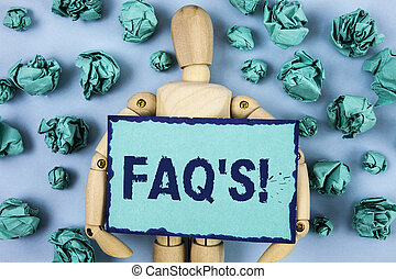 Word writing text Faq'S Motivational Call. Business concept for Multiple questions answered for online product written on Sticky note paper within Paper Balls on plain background Jointed Toy