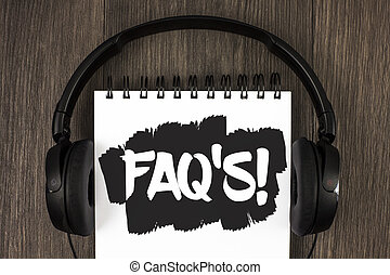 Word writing text Faq'S Motivational Call. Business concept for Multiple questions answered for online product written on Notepad on the wooden background Headphone next to it.