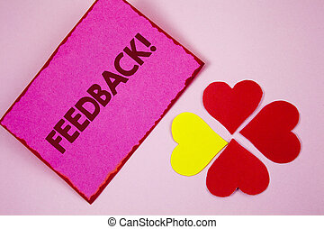 Word writing text Feedback Motivational Call. Business concept for Rating an economical local grocery store written on Sticky note paper on plain Pink background Paper Hearts next to it.