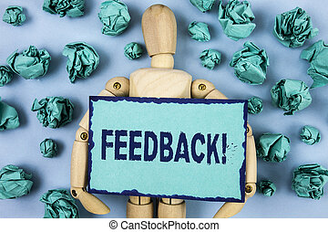 Word writing text Feedback Motivational Call. Business concept for Rating an economical local grocery store written on Sticky note paper within Paper Balls on plain background Jointed Toy