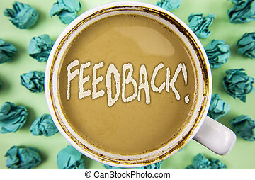 Word writing text Feedback Motivational Call. Business concept for Rating an economical local grocery store written on Tea in White Cup within Crumpled Paper Balls on plain background.