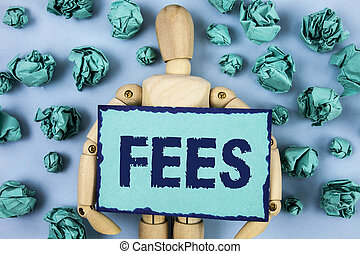 Word writing text Fees. Business concept for Online creative agency charges product components hourly costs written on Sticky note paper within Paper Balls on plain background Jointed Toy